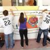 El Cuerpo de Voluntarios de los Medias Blancas Transforman una Comunidad
